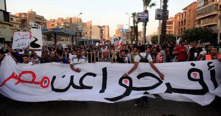 "FILE PHOTO - Demonstrators shout slogans against Egypt's former army chief Abdel Fattah al-Sisi and against a law restricting demonstrations near El-Thadiya presidential palace in Cairo, April 26, 2014. The banner reads ""Release Egypt"". REUTERS/Amr Abdallah Dalsh/File Photo"