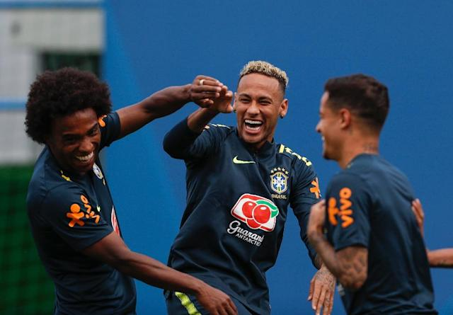 Coutinho with Willian (L) and Neymar at Brazil training on Tuesday (AFP Photo/Adrian DENNIS)