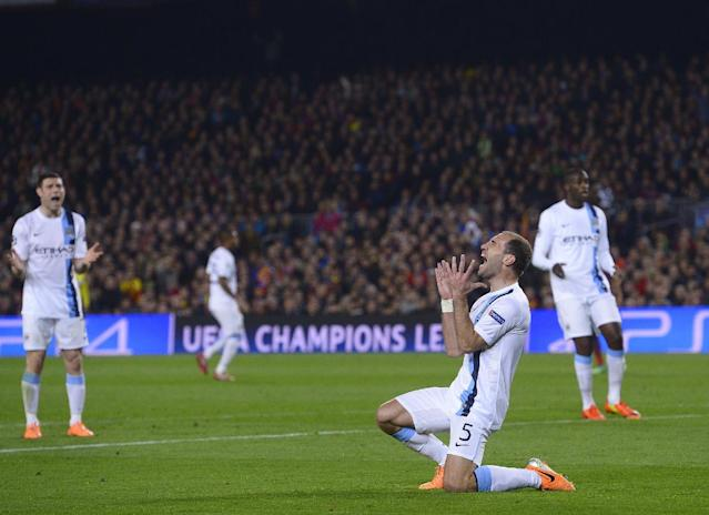 Manchester City's Pablo Zabaleta reacts after missing a shot at goal during a Champions League, round of 16, second leg, soccer match between FC Barcelona and Manchester City at the Camp Nou Stadium in Barcelona, Spain, Wednesday March 12, 2014. (AP Photo/Manu Fernandez)