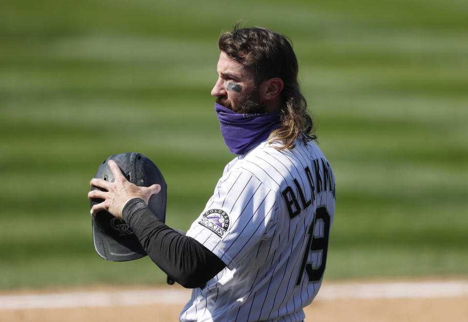 Colorado Rockies' Charlie Blackmon waits to bat against Texas Rangers relief pitcher Jimmy Herget in the eighth inning of a baseball game Sunday, Aug. 16, 2020, in Denver.  (AP Photo/David Zalubowski)