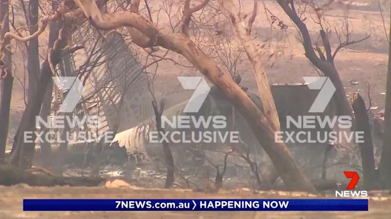 A Coulson Aviation aircraft lies smouldering and smashed in the Snowy Mountains of NSW.