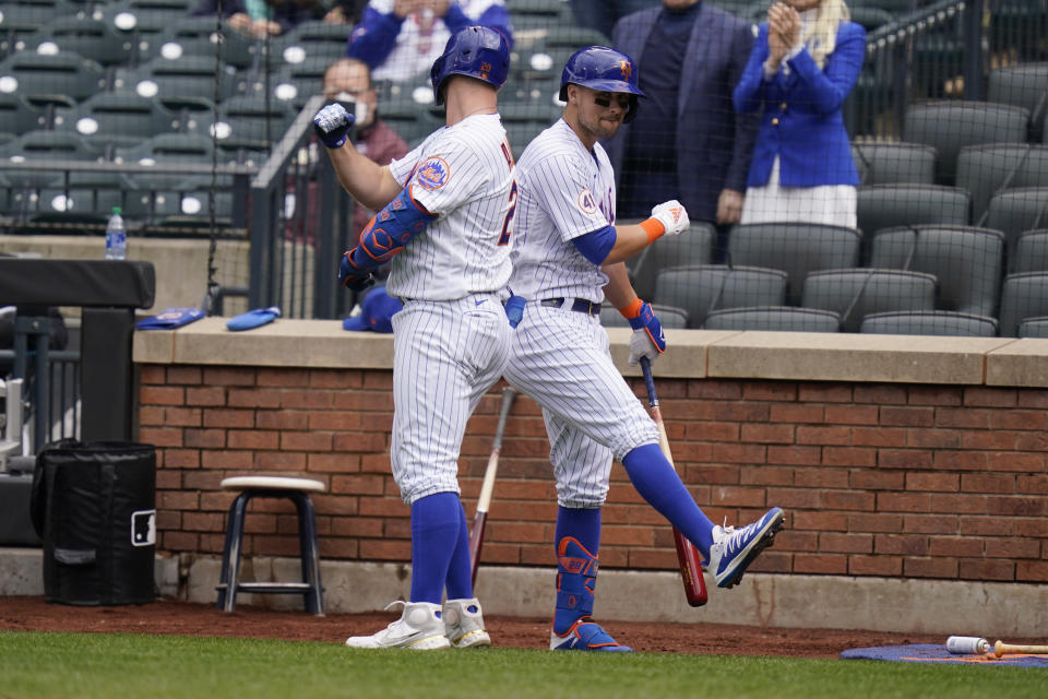 New York Mets' Pete Alonso, left, celebrates his home run with J.D. Davis during the fifth inning of a baseball game against the Washington Nationals at Citi Field, Sunday, April 25, 2021, in New York. (AP Photo/Seth Wenig)