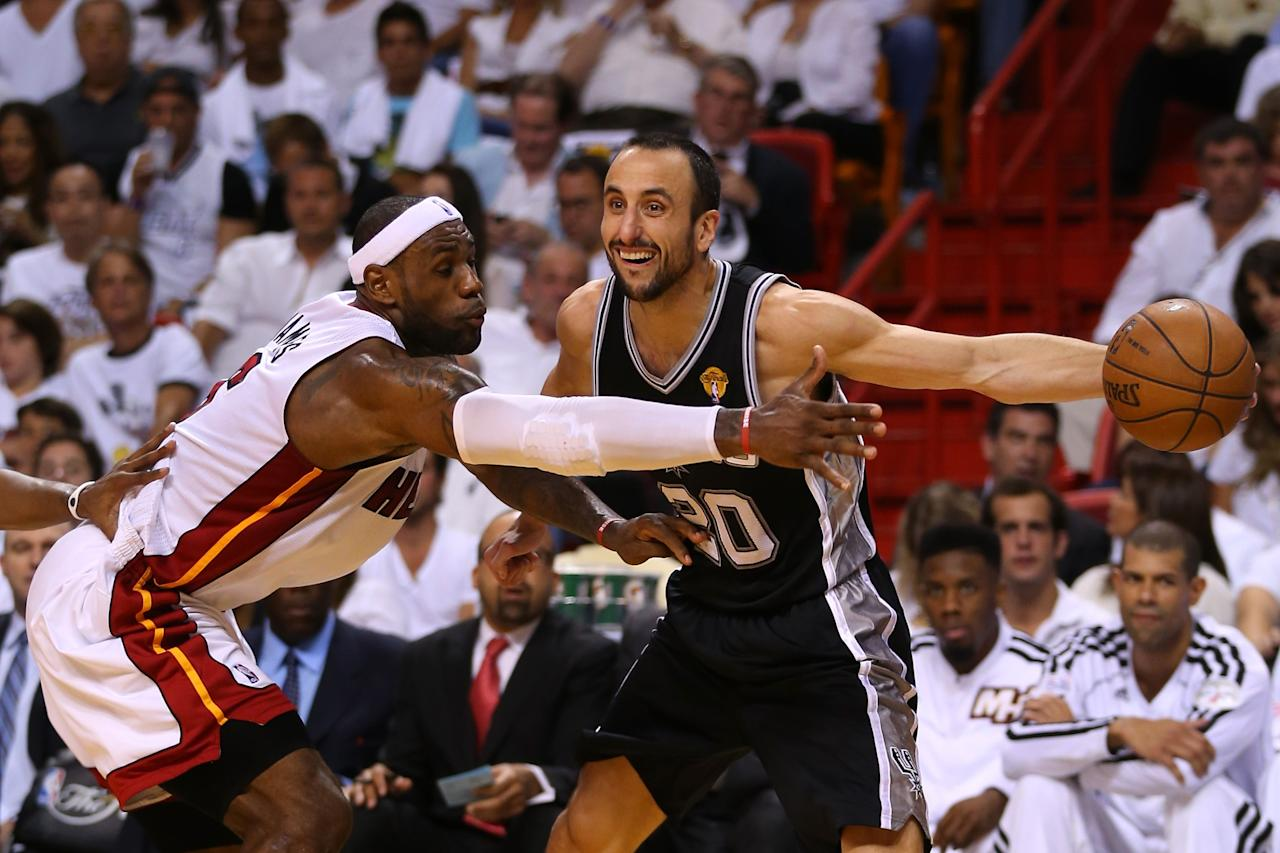 MIAMI, FL - JUNE 18: Manu Ginobili #20 of the San Antonio Spurs with the ball against LeBron James #6 of the Miami Heat during Game Six of the 2013 NBA Finals at AmericanAirlines Arena on June 18, 2013 in Miami, Florida. NOTE TO USER: User expressly acknowledges and agrees that, by downloading and or using this photograph, User is consenting to the terms and conditions of the Getty Images License Agreement. (Photo by Mike Ehrmann/Getty Images)
