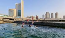 Libyans swim in the Mediterranean at the capital Tripoli's waterfront. Libya's infrastructure has been devastated by a decade of conflict, state collapse and neglect since the 2011 overthrow and killing of dictator Moamer Kadhafi