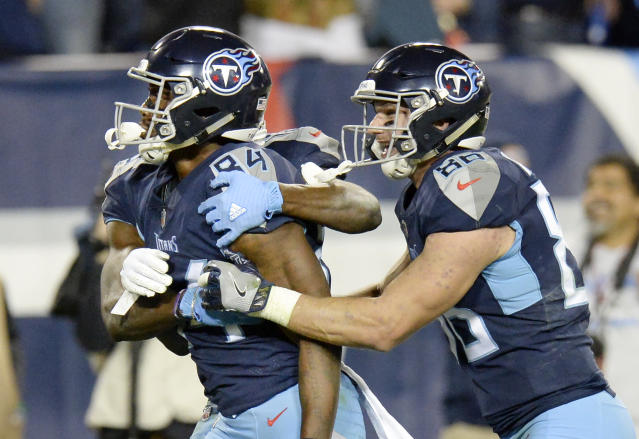 Tennessee Titans wide receiver Corey Davis (84) celebrates with tight end Anthony Firkser (86) after Davis caught the winning touchdown against the New York Jets in the fourth quarter of an NFL football game Sunday, Dec. 2, 2018, in Nashville, Tenn. The Titans won 26-22. (AP Photo/Mark Zaleski)