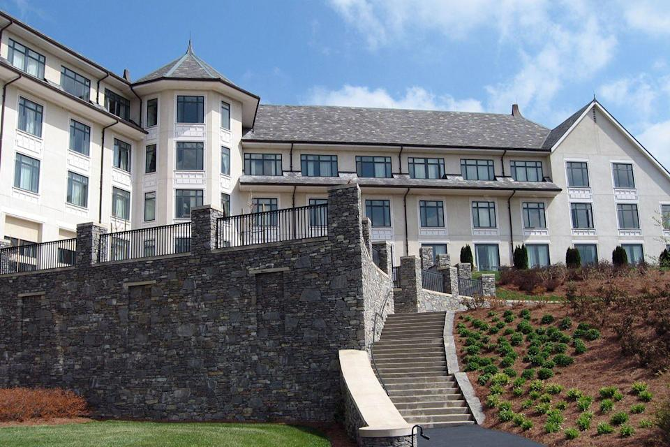 "<p>One of Asheville's finest hotels sits on the grounds of Biltmore Estate, the <span class=""redactor-unlink"">Châteauesque</span>-style mansion built by George and Edith <span class=""redactor-unlink"">Vanderbilt</span>. The gorgeous setting, complete with pool, fine-dining restaurant, and an envy-inducing library might make you feel like you're American royalty, just like the Vanderbilts.<br></p><p><strong>EXPLORE NOW:</strong> <a href=""https://www.tripadvisor.com/Hotel_Review-g60742-d255249-Reviews-The_Inn_on_Biltmore_Estate-Asheville_North_Carolina.html"" rel=""nofollow noopener"" target=""_blank"" data-ylk=""slk:The Inn on Biltmore Estate"" class=""link rapid-noclick-resp"">The Inn on Biltmore Estate</a></p><p><em>Image via <a href=""https://www.flickr.com/photos/cohenkenny/499683987/"" rel=""nofollow noopener"" target=""_blank"" data-ylk=""slk:PAULINE KENNY"" class=""link rapid-noclick-resp"">PAULINE KENNY</a>/Flickr</em></p>"