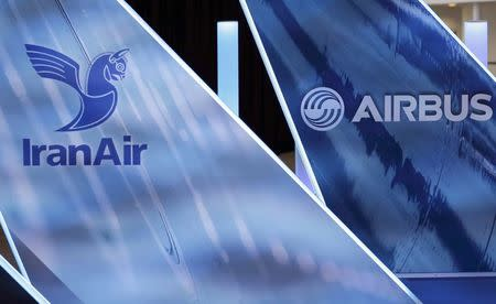 The logos of Airbus group and IranAir are pictured the company IranAir takes delivery of the first new Western jet, an Airbus A321, under an international sanctions deal in Colomiers, near Toulouse, France, January 11, 2017.   REUTERS/Regis Duvignau