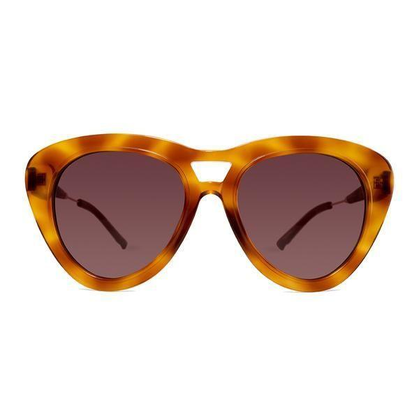"""<p><strong>Coco and Breezy</strong></p><p>cocoandbreezy.com</p><p><strong>$285.00</strong></p><p><a href=""""https://cocoandbreezy.com/collections/sunglasses/products/moxi-104"""" rel=""""nofollow noopener"""" target=""""_blank"""" data-ylk=""""slk:SHOP NOW"""" class=""""link rapid-noclick-resp"""">SHOP NOW</a></p><p>Even though these specs from Coco and Breezy aren't spot on, they are a similar hue and are definitely just as bold. If you're absolutely obsessed with the lighter-colored pattern like she had and you're into unconventional shapes, this one just may be your match.</p>"""