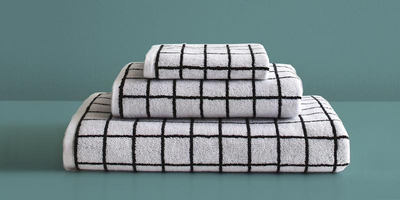 Towels that mimic one of our favorite bathroom features: rows and rows of white tile. SHOP NOW: Mini Grid Black Bath Towel by Unison, $38, unisonhome.com