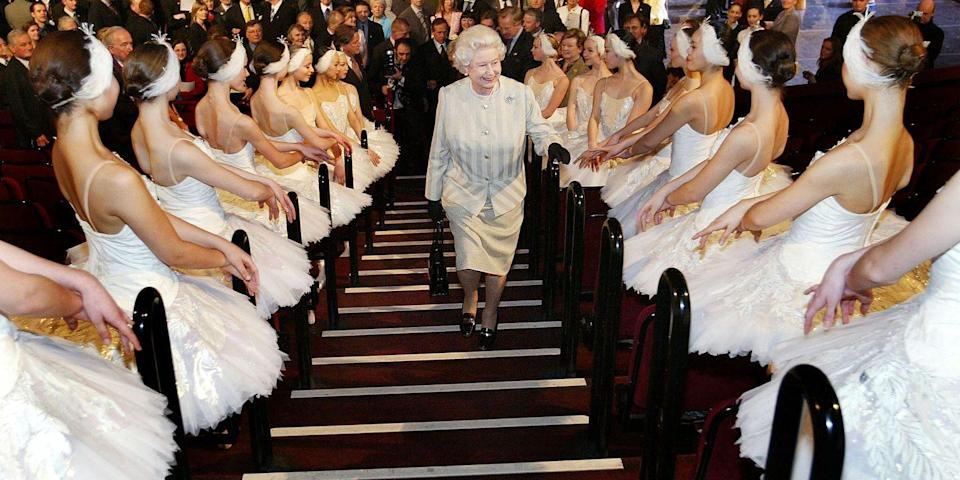 <p>The queen greeted ballerinas who lined the staircase at Royal Albert Hall.</p>
