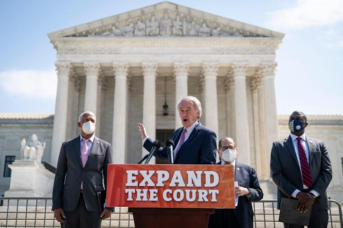 From left, Rep. Hank Johnson, D-Ga.; Sen. Ed Markey, D-Mass.; House Judiciary Committee Chairman Jerry Nadler, D-N.Y.; and Rep. Mondaire Jones, D-N.Y., hold a news conference April 15 in front of the U.S. Supreme Court to announce legislation that would expand the number of seats on the court from nine to 13 justices.