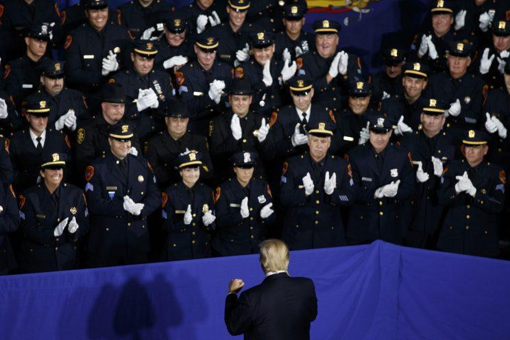 Law enforcement officers applaud President Trump as he arrives to deliver a speech in Brentwood, N.Y., July 28, 2017. (Photo: Evan Vucci/AP)