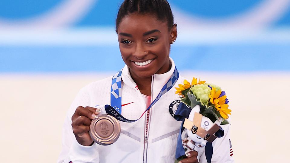 Simone Biles impressively won the bronze medal in the balance beam, after withdrawing from the majority of her Tokyo Olympics program. (Photo by Laurence Griffiths/Getty Images)