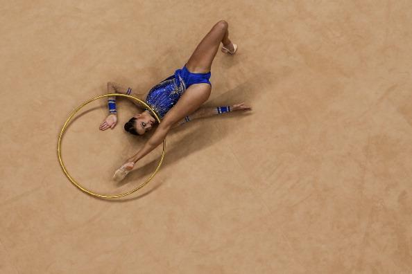LONDON, ENGLAND - AUGUST 09: Evgeniya Kanaeva of Russia competes in the Individual All-Around Gymnastics Rhythmic on Day 13 of the London 2012 Olympics Games at Wembley Arena on August 9, 2012 in London, England.(Photo by Chris McGrath/Getty Images)