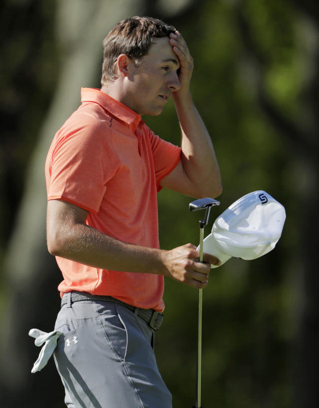 Jordan Spieth wipes his brow after putting on the ninth green during the third round of the PGA Championship golf tournament, Saturday, May 18, 2019, at Bethpage Black in Farmingdale, N.Y. (AP Photo/Julio Cortez)