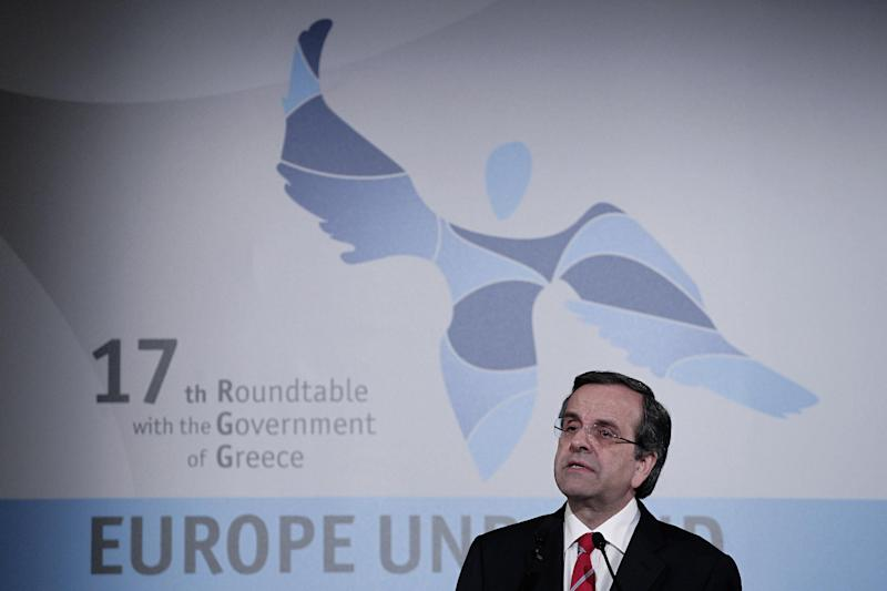 Greece's Prime Minister Antonis Samaras delivers his speech during an conference on the economy in central Athens, Tuesday, April 16, 2013. Greece's finance minister pledged Tuesday to stick with unpopular austerity measures and correct years of profligate state spending, in the hope of securing a budget surplus this year that could pave the way for a new debt reduction deal. (AP Photo/Petros Giannakouris)