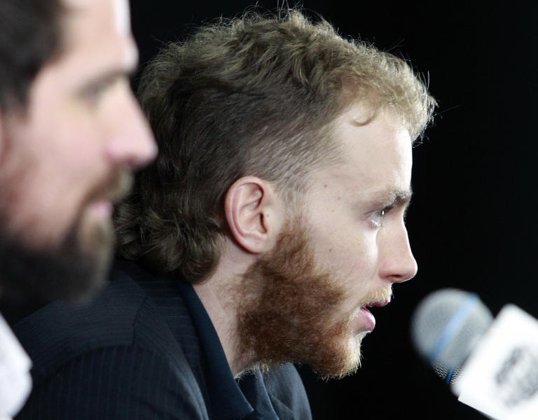 Chicago Blackhawks right wing Patrick Kane, right, answers a reporter's question during a media availability Sunday, June 23, 2013, in Boston. At left is Chicago Blackhawks center Patrick Sharp. The Blackhawks will face the Boston Bruins in Game 6 of the NHL hockey Stanley Cup Final Monday night in Boston. (AP Photo/Bill Sikes)