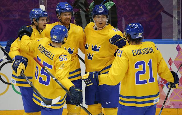 Team Sweden celebrates a third period goal against Slovenia during a men's quarterfinal ice hockey game at the 2014 Winter Olympics, Wednesday, Feb. 19, 2014, in Sochi, Russia. (AP Photo/Mark Humphrey)