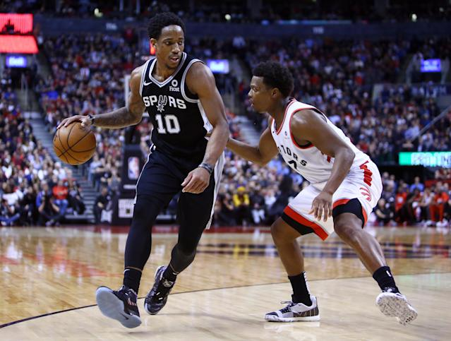 DeMar DeRozan dribbles against former teammate Kyle Lowry during the second half Friday night. (AP)