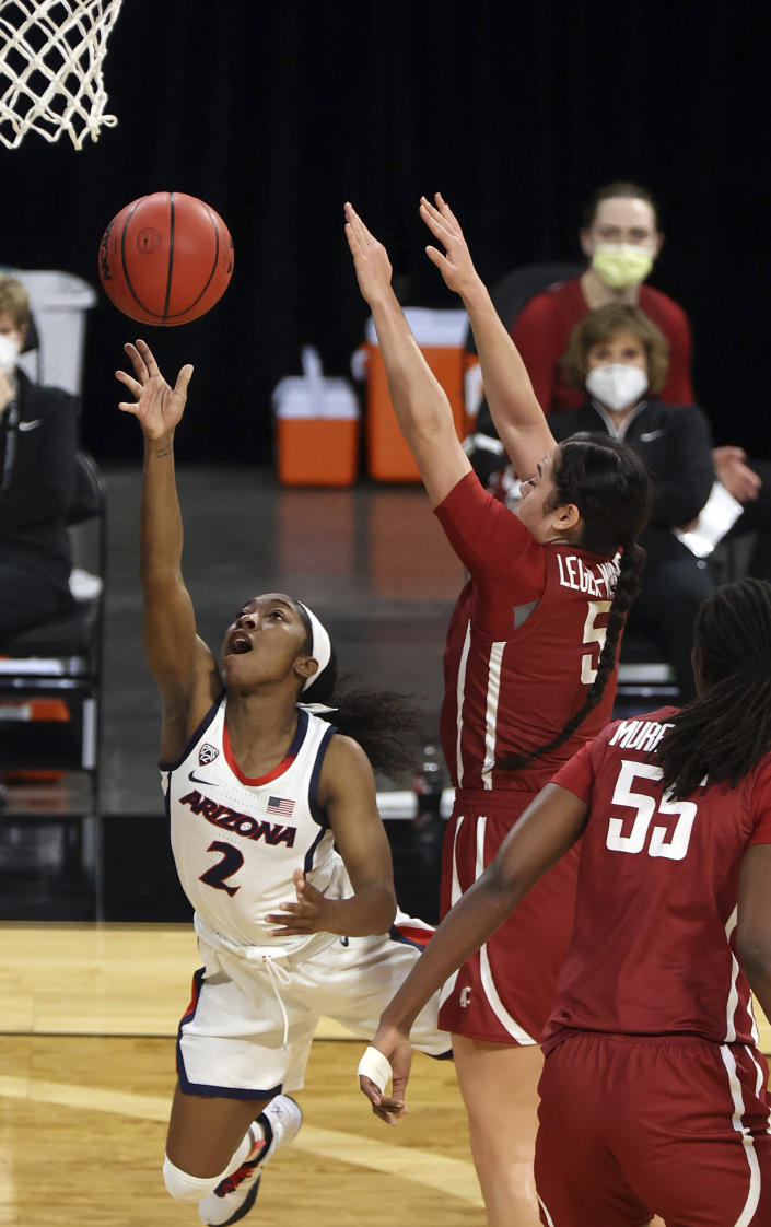 Arizona guard Aari McDonald (2) shoots as Washington State guard Charlisse Leger-Walker (5) defends during the first half of an NCAA college basketball game in the second round of the Pac-12 women's tournament Thursday, March 4, 2021, in Las Vegas. (AP Photo/Isaac Brekken)