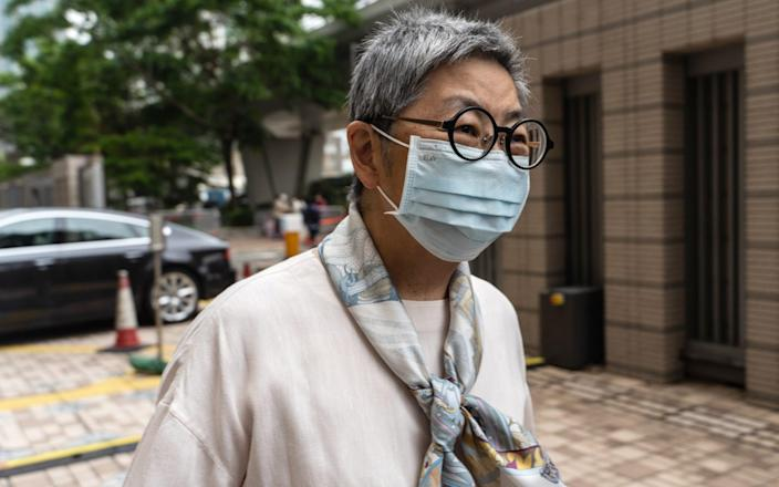 """Margaret Ng, former lawmaker, arrives for a mitigation and sentencing hearing at the West Kowloon Magistrates Courts in Hong Kong, China, on Friday, April 16, 2021. Hong Kong's """"father of democracy"""" Martin Lee and media mogul Jimmy Lai were among a group of opposition activists found guilty for attending an unauthorized protest in 2019, in the latest blow to the city'™s beleaguered opposition - Chan Lon Hei/Bloomberg"""