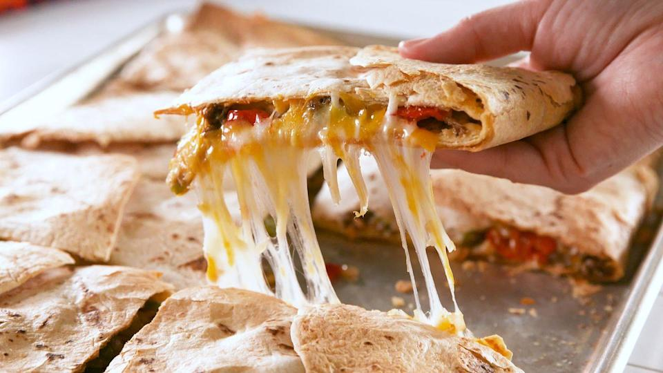 "<p>Perfect for feeding a hungry crowd, it's safe to say we'll never go back to making regular quesadillas again.</p><p>Get the recipe from <a href=""https://www.delish.com/cooking/recipe-ideas/a20127976/sheet-pan-quesadillas-recipe/"" rel=""nofollow noopener"" target=""_blank"" data-ylk=""slk:Delish"" class=""link rapid-noclick-resp"">Delish</a>.</p>"