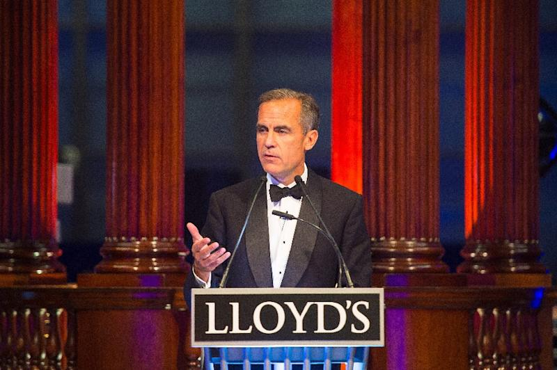 The Governor of the Bank of England, Mark Carney, speaks at a dinner at Lloyd's of London, on September 29, 2015 (AFP Photo/Dominic Lipinski)