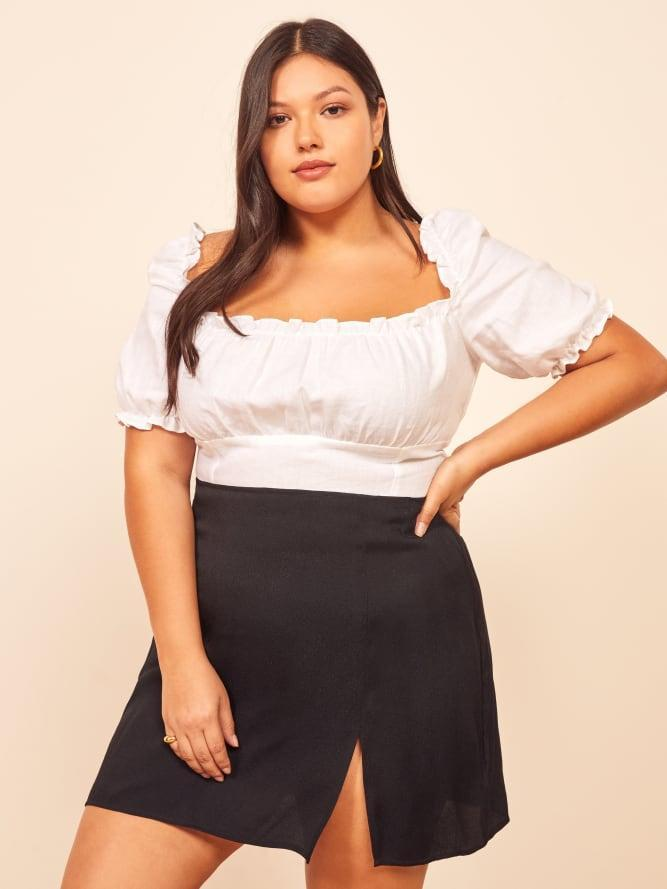 """<br><br><strong>Reformation</strong> Margot Skirt, $, available at <a href=""""https://go.skimresources.com/?id=30283X879131&url=https%3A%2F%2Fwww.thereformation.com%2Fproducts%2Fmargot-skirt-es"""" rel=""""nofollow noopener"""" target=""""_blank"""" data-ylk=""""slk:Reformation"""" class=""""link rapid-noclick-resp"""">Reformation</a>"""