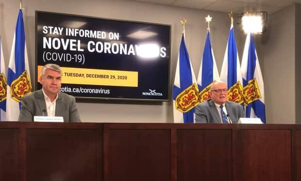 Premier Stephen McNeil and Dr. Robert Strang, the province's chief medical officer of health, hold a COVID-19 briefing in Halifax on Dec. 29, 2020.