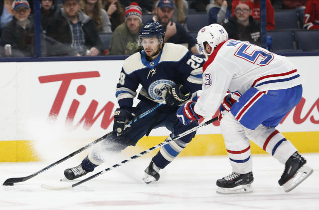 Columbus Blue Jackets' Oliver Bjorkstrand, left, of Denmark, looks for an open pass as Montreal Canadiens' Victor Mete defends during the second period of an NHL hockey game Tuesday, Nov. 19, 2019, in Columbus, Ohio. (AP Photo/Jay LaPrete)