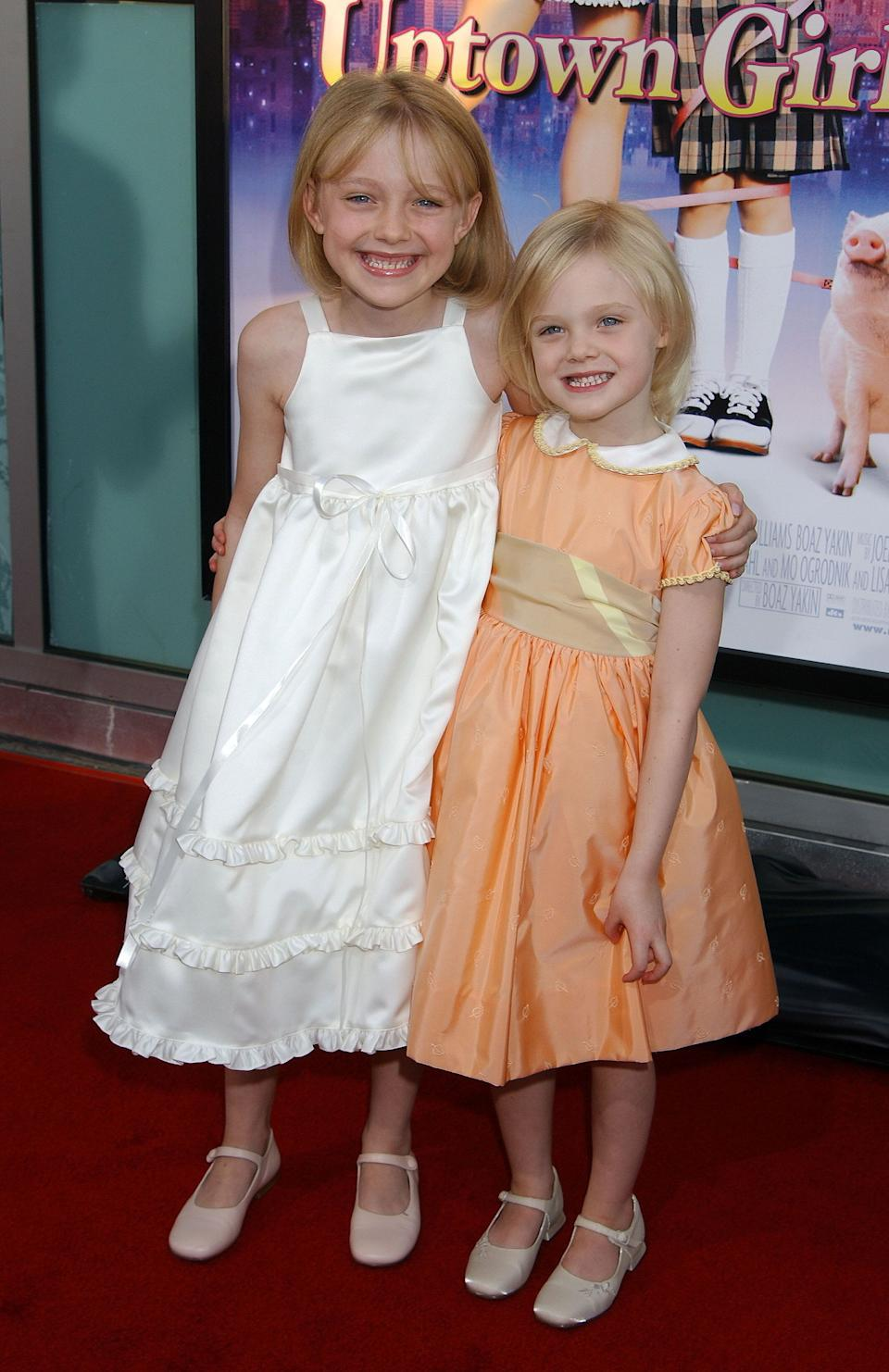 "The Fanning sisters at the ""Uptown Girls"" premiere at Archlight Theatre in Hollywood."