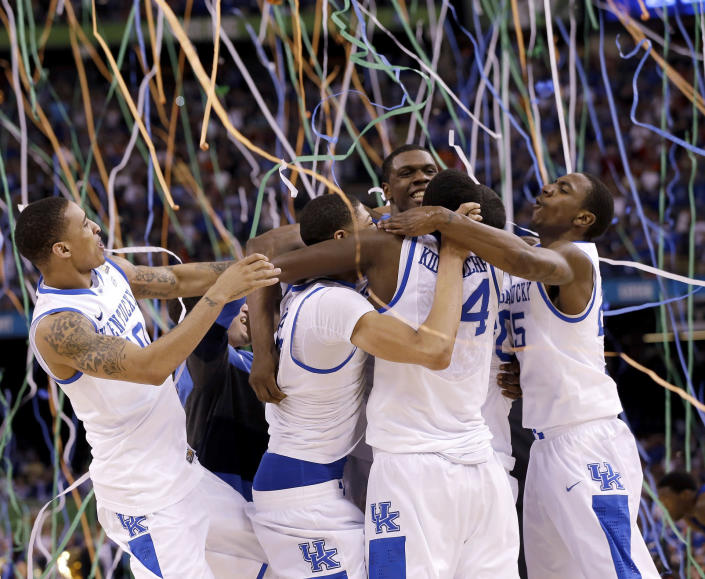 FILE - In this April 2, 2012, file photo, Kentucky players celebrate at the end of the NCAA Final Four tournament college basketball championship game against Kansas, in New Orleans. (AP Photo/David J. Phillip, File)