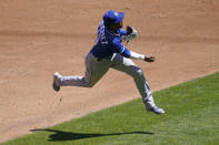 Kansas City Royals third baseman Kelvin Gutierrez throws out Minnesota Twins' Nelson Cruz after fielding his grounder in the third inning of a baseball game, Saturday, May 29, 2021, in Minneapolis. (AP Photo/Jim Mone)