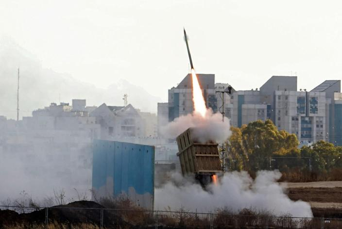 A missile fires into the sky.