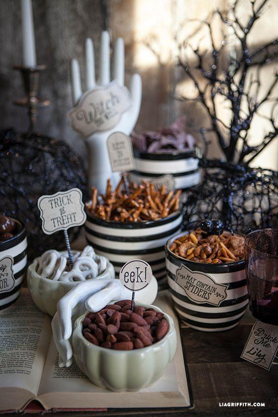 """<p>If you're hosting a more casual Halloween affair, you can still deck out your dining table without having fancy schmancy centerpieces. Use designer Lia Griffith's free printables to create a spooky spread of your Halloween apps. </p><p><strong>Get the tutorial at <a href=""""https://go.redirectingat.com?id=74968X1596630&url=http%3A%2F%2Fliagriffith.com%2Fhalloween-party-printables%2F&sref=https%3A%2F%2Fwww.countryliving.com%2Fhome-design%2Fdecorating-ideas%2Fg3739%2Fhalloween-centerpieces%2F"""" rel=""""nofollow noopener"""" target=""""_blank"""" data-ylk=""""slk:Lia Griffith"""" class=""""link rapid-noclick-resp"""">Lia Griffith</a>.</strong> </p>"""
