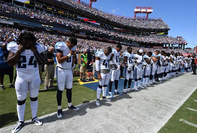 <p>Tennessee Titans players observe a moment of silence before the game against the Minnesota Vikings at Nissan Stadium. Mandatory Credit: Christopher Hanewinckel-USA TODAY Sports </p>