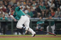 Seattle Mariners' Ty France heads for first after hitting an RBI single during the seventh inning of the team's baseball game against the Los Angeles Angels on Friday, July 9, 2021, in Seattle. (AP Photo/Ted S. Warren)
