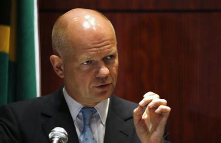 British Foreign Secretary William Hague addresses media conference in Cape Town