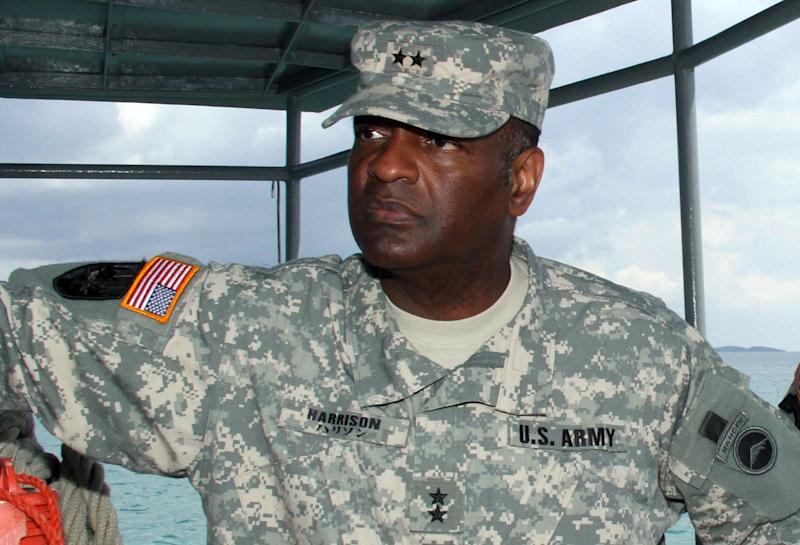 In this image provided by the Army, Maj. Gen. Michael T. Harrison Sr., left, commander of U.S. Army Japan and I Corps (Forward), stands aboard a craft near Tengan Pier in Okinawa, Japan, during a tour of some of the 505th Quartermaster Battalion's facilities on Chibana Compound. Harrison has been suspended from his duties for allegedly failing to report or properly investigate an allegation of sexual assault, the Army said Friday, June 7, 2013. Harrison was suspended by the Army chief of staff, Gen. Ray Odierno, and Army Secretary John McHugh, the Army said. (AP Photo/U.S. Army, Chip Steitz)