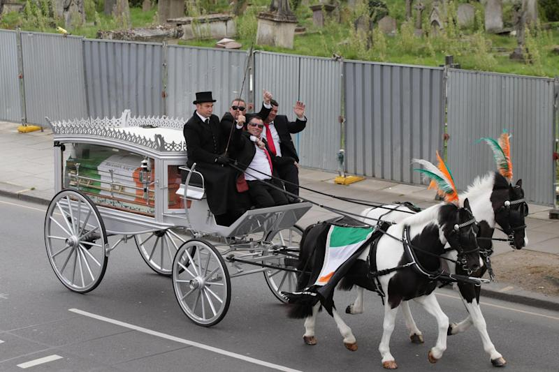 My Big Fat Gypsy Wedding star Paddy Doherty (centre), with his brothers Qe (front) and Johnny (right) on a horse drawn hearse on Harrow Road: PA