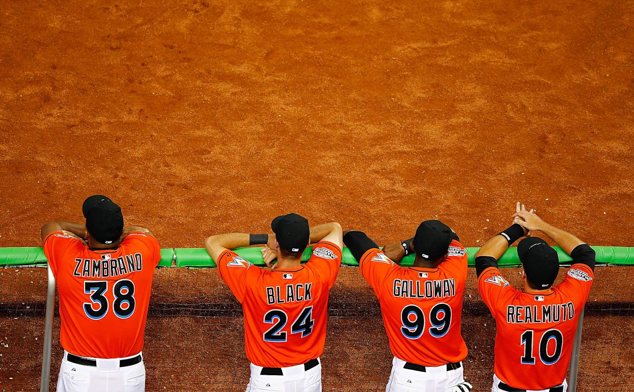 MIAMI, FL - APRIL 01: Carlos Zambrano #38 of the Miami Marlins and teammates look on during a game against the New York Yankees at Marlins Park on April 1, 2012 in Miami, Florida. (Photo by Mike Ehrmann/Getty Images)