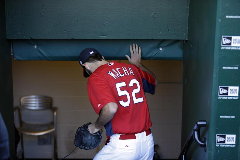 St. Louis Cardinals starting pitcher Michael Wacha has to duck as he walks through the dugout to the Cardinals' clubhouse Friday, Oct. 25, 2013, in St. Louis. Wacha was the winner in Game 2 of the World Series against the Boston Red Sox on Thursday helping the Cardinals tie the series at 1-1. (AP Photo/Jeff Roberson)