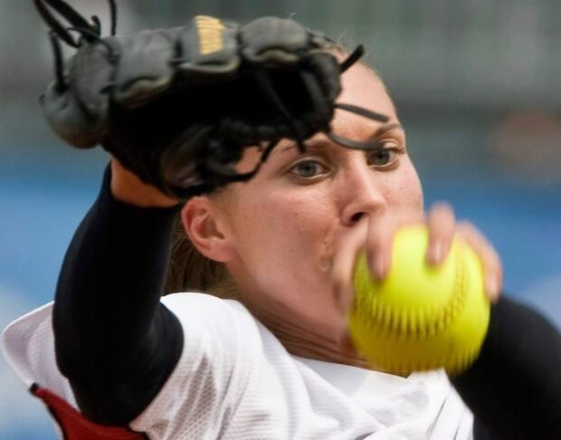 Canadian softball pitcher Lauren Bay-Regula, shown during her last Olympic game in 2008, discusses the pain and pleasure of returning to competition thirteen years and three children after she retired from the sport. (Paul Chiasson/The Canadian Press - image credit)