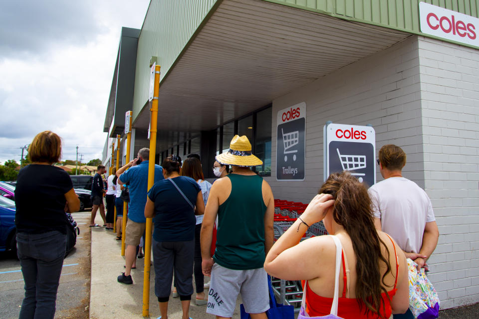 People queuing at Coles grocery store. Source: Getty Images