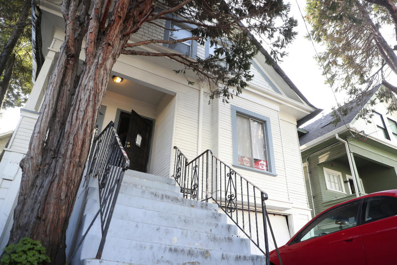 In this photo taken Dec. 24, 2019, is a home along Magnolia Street that is being occupied by the group Moms 4 Housing in West Oakland, Calif. The women took over the home after they said they were unable to find permanent housing in the Bay Area, where high-paying tech jobs have exacerbated income inequality and a housing shortage. They also say they're protesting real estate developers who snap up distressed homes, then leave them empty.  (Aric Crabb/Bay Area News Group via AP)