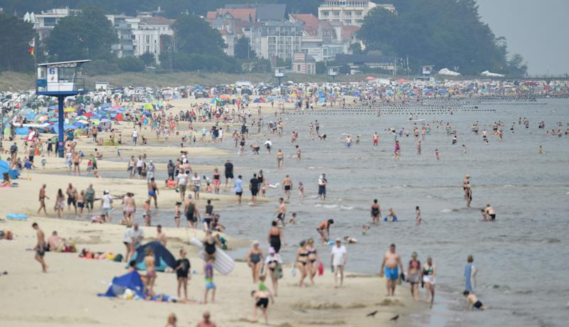 28 June 2020, Mecklenburg-Western Pomerania, Heringsdorf: Tourists use the high summer weather on the beach on the island of Usedom for sunbathing and swimming. However, day tourists are not allowed to travel further into the federal state. Photo: Stefan Sauer/dpa (Photo by Stefan Sauer/picture alliance via Getty Images)