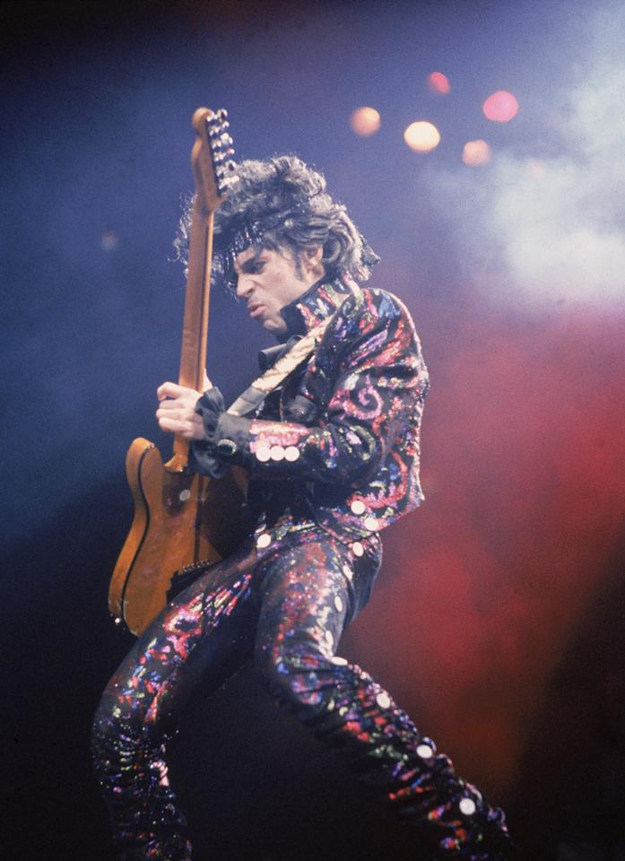 <p>Prince was just as inspiring in his fashion choices as he was in his music, and both were a totally original mix of styles. The man was definitely not afraid of a little (or a lot of) ruffle and did not shy away from bold patterns and fly accessories.</p><p><i><i>(Photo: Getty)</i></i></p>