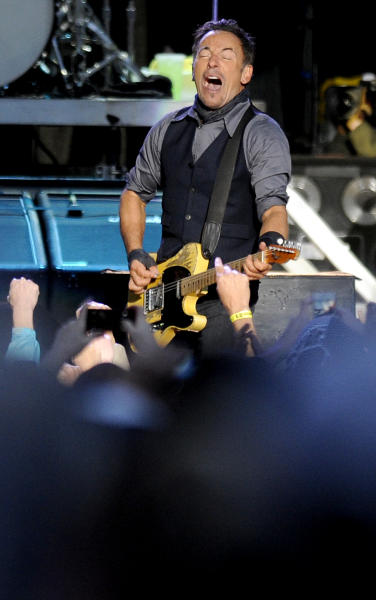 Bruce Springsteen performs with the E Street Band during the 2014 NCAA March Madness Music Festival - Capital One JamFest, Sunday, April 6, 2014, in Dallas. (Photo by Matt Strasen/Invision/AP)