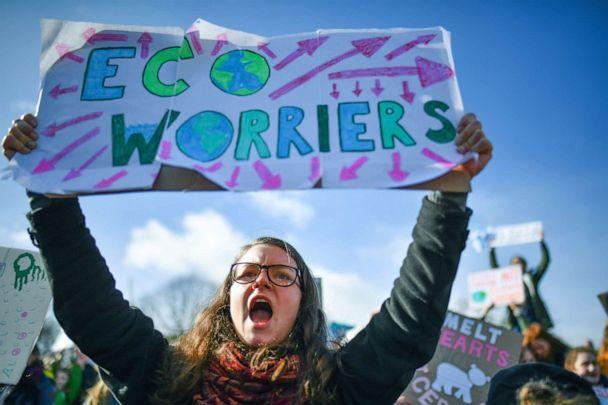 PHOTO: School children hold signs and shout slogans as they participate in a climate change awareness protest outside the Scottish Parliament on March 15, 2019, in Edinburgh, Scotland. (Jeff J Mitchell/Getty Images)
