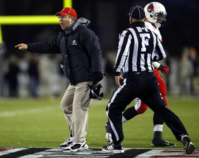 Ball State coach Pete Lembo runs out onto the field during the first half of his team's NCAA college football game against Northern Illinois on Wednesday, Nov. 13, 2013, in DeKalb, Ill. (AP Photo/Jeff Haynes)